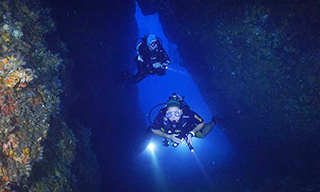 A couple of divers enjoying a cave in Myanmar