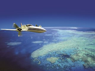 Jetstar flying over the Great Barrier Reef