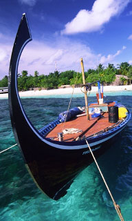 Traditional-style longtail boat, Indian Ocean - photo courtesy of ScubaZoo