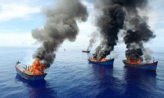 Arial view of Palau burning illegal Vietnamese fishing boats