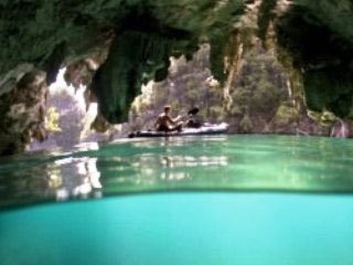 Kayaking past a cave mouth near Misool in the Raja Ampat - photo courtesy of Ethan Daniels