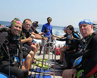 Happy divers, including Jim diving from White Manta's tender