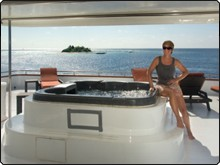 MV Carpe Vita Explorer's sun deck hot tub; relax and enjoy the scenery of the Maldives