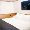 Luxury stateroom with double bed and porthole