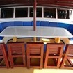 The main deck's dining / covered seating area