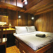 Standard double bed cabin with wooden panelling