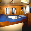M/V Undersea Hunter's upper deck cabin, queen bed with sea view windows