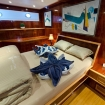 Master suite with double bed, reading lights and portholes