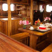 Open plan galley and dining on Calico Jack