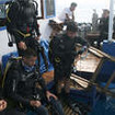 Gearing up for diving Komodo on the stern of Mastro Aldo