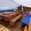The shaded are above deck for dining and relaxing