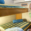 Standard twin bed stateroom with shared bathroom on the Turks-Caicos liveaboard
