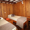 Deluxe twin bed cabin with reading lights, storage spaces