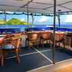 Beautiful Fijian islands provide a picturesque backdrop for your open air dining