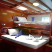 Lower deck twin cabin with 1 large bed and 1 single upper bunk