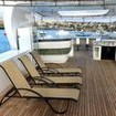 The upper deck features BBQ, bar and sun loungers