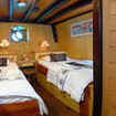 Standard twin bed cabin with porthole and reading lights