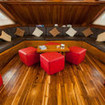 Meet fellow Ecoventura Galapagos cruise guests in the comfortable saloon
