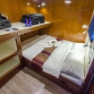 Deluxe cabin on The Smiling Seahorse with double bed configuration