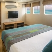 Upper deck double bed suite with picture windows