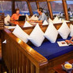 Relax in the comfortable saloon during your cruise