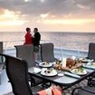 Alfresco sunset dining on Kona Aggressor's upper deck