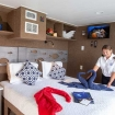 Balcony double bed suite aboard the Cayman Aggressor V liveaboard