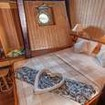 Standard double bed cabin on the liveaboard's lower deck