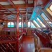 The wooden interior of the dining area and bridge of Nautilus One