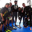 Scuba Adventure guests geared up on the dive deck