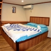The Executive double bed suite on MV Emperor Leo