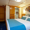 Stateroom cabin is located in  a private area on the lower deck