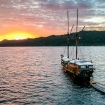 KLM Jaya and dinghies watching the sunset in Indonesia