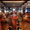 The stately saloon aboard the Indonesian liveaboard, S/Y Indo Siren
