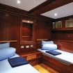 Classic twin bed cabins on lower deck with mirror, charging points