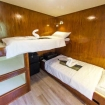 Standard cabin on Smiling Seahorse with twin bunk bed configuration