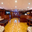 M/Y Saphir's saloon and bar area adjoining the dining area
