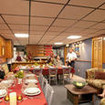 Indoor dining and relaxation aboard the Kona Aggressor II liveaboard