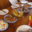 Family-style dining onboard the Tatawa liveaboard in Indonesia