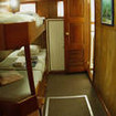 Twin share bunk bed cabin with portholes