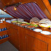 Dining Indonesian buffet style aboard the Mermaid II liveaboard