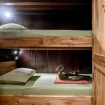 A twin bed cabin with bunk beds