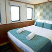 The spacious and bright Ocean View Deluxe cabin