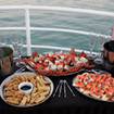 Scrumptious canapes, crab and bubbly served onboard