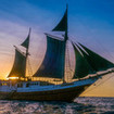 The SMY Ondina liveaboard, basks in the golden Indonesian sunset