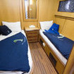 Standard twin bed liveaboard accommodation onboard MY Dreams in the Red Sea
