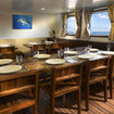 Preparing for lunch in the dining area of this Indonesia liveaboard