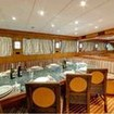 Replenish your energy in the dedicated dining area aboard the M/Y Blue Pearl