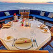 Candlelit dining during your Pelagian liveaboard diving cruise