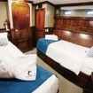 Deluxe twin bed cabin accommodation aboard Galapagos Sky